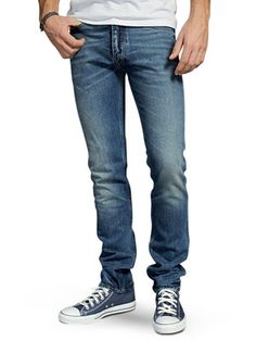 JEANS Slim fit jeans should slightly hug the thighs, knees, and calves while loosening up around your ankles.