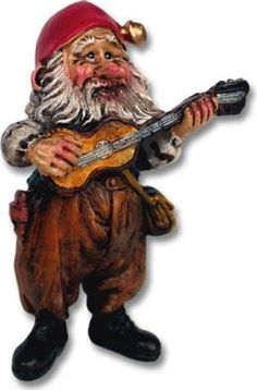 """Nisse with Guitar SKU: 46805 U$14.50 Norwegian artist Kjell Midthun has created a  special world of delightfully active nisser,  like his musically-inclined Nisse with Guitar.  Made in China to high Scandinavian safety  and quality standards.  Handpainted polyresin. 4"""""""