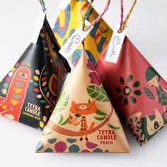 可愛い三角のアロマキャンドルを オリジナルテトラ紙にお包みした テトラキャンドル6個入り。
