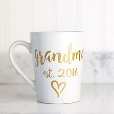"The perfect gift for any new grandmother, or a great way to surprise a grandmother-to-be with the news! This 14 oz mug features the ""grandma"" with any est. year of your choice, in our beautiful gold s                                                                                                                                                                                 More"