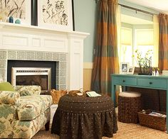 Blue + Green  Earthy shades of blue and green are an inviting mix for a welcoming room. Typically considered cool colors, blues and greens find common ground in a cozy room when combined with khaki, beige, and dark brown. Rusty orange in the curtains and a gold-colored throw are the ideal layer for the chillier months ahead.