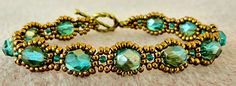 "Linda's Crafty Inspirations: Bracelet of the Day: Waves of Wonder Materials:  11/0 seed beads Miyuki ""Dark Bronze"" (11-457D) 11/0 seed beads Miyuki ""Emerald Lined"" (11-1933) 6mm fire polished beads ""Aquamarine Celsian"""