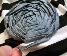 How to sew a flat flower embellishment onto clothing using a sewing machine.