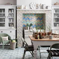 The SomerTile 3x6-inch Antiguo Special Lava Verde Ceramic Wall Tile features uneven edges for a handmade look. These high sheen tiles feature a reactive glaze and slight variation in its smooth surface for added depth.
