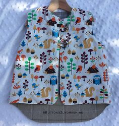 Items similar to Bodywarmer / Gilet ,Wool lined reversible, ,reversible childs, age warm and cosy in woodland fabrics and wool lining. Twig and tail on Etsy Heavy Clothing, Woodland Fabric, Body Warmer, Cotton Lights, Wool Fabric, Kids Wear, Fabric Patterns, Cosy, Floral Tops
