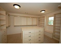 Serene master suite with fireplace,   built-ins and huge walk-in closet with organization system. *Contact Karen Cannon Realtors 770-352-9658