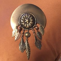 Pin Awesome looking pin.  Looks great on a coat or jacket. Gold, rose gold & silver are included is the pin colours. Other