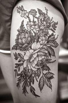 Wonderful black-ink flowers tattoo on thigh