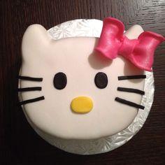 hello kitty pound cake with vanilla buttercream covered with buttercream fondarific fondant