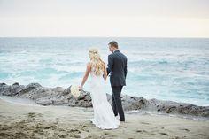 Bride and Groom Walking along the Ocean