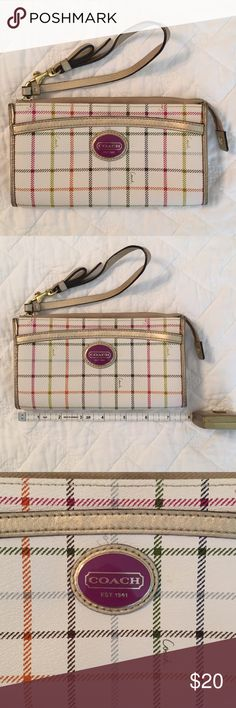 Coach wallet wristlet plaid Used a handful of times. Some wear on the gold leather edges. Inside is like new. Very buttery soft brown leather inside with magenta lining. Outside is cream base with various colored lines. Coach Bags Clutches & Wristlets