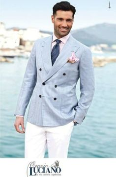 Shop this look for $549:  http://lookastic.com/men/looks/chinos-and-double-breasted-blazer-and-tie-and-dress-shirt-and-pocket-square/2146  — White Chinos  — Light Blue Double Breasted Blazer  — Navy and White Polka Dot Tie  — Pink Dress Shirt  — Pink Silk Pocket Square