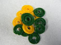 Go Pack!  Some packer lampwork discs.   Still need to make something out of them.