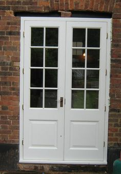 Simple elegance. White patio doors by Merrin Joinery. #patio #french #double #doors