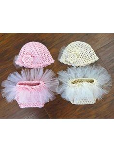 "This diaper set is ""tutu"" cute! Made holding 2 stands together of approximately 250--300 yds of worsted-weight yarn for a cute, bulky look. Once the diaper cover is made, written instructions along with photos are given on how to cut and attach the strips of tulle. Sizes: NB: hat: 12""W x 5""H, diaper cover waist: 9"" to 12"" with a 5 1/3"" rise; 0-3 mos: hat: 14""W x 5 1/2""H, diaper cover waist: 9"" to 13"" with a 6"" rise."