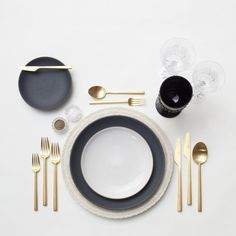RENT: Lace Chargers in White + Heath Ceramics in Indigo/Slate/Opaque White + Rondo Flatware in Brushed 24k Gold + Czech Crystal Stemware + Vintage Black Goblets + Antique Crystal Salt Cellars  SHOP:Rondo Flatware in Brushed 24k Gold
