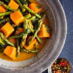 This flavorful Thai red curry recipe matches sweet potatoes with fresh dandelion greens and asparagus, though you can also substitute cauliflower florets, cubed Asian eggplant, squash or carrots.