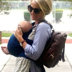 One more, because I can't resist . This is why I created Lily Jade--to love on mommies and free your arms up to hold on to the things that really matter . #armsareforhugging (Brand new style pictured is the Meggan in Brandy, which can be worn as a backpack .)