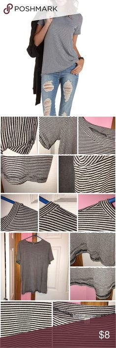 """Crew Neck Striped Tunic Tee Worn a bunch of times so has some signs of wear. Does have pilling. Very comfortable. (Shorts are NOT for sale that I'm modeling with the tee in the photo.) 62% polyester, 33% rayon, and 5% spandex. Laying flat approx 28"""" in length and bust is approx 43"""". ❌❌NO TRADES❌❌ 👉🏻👉🏻ALL items under $10 prices are firm unless bundled. 👈🏻👈🏻 Charlotte Russe Tops Tunics"""