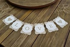 """The perfect banner to decorate your special occasion -perfect for Engagement parties, wedding proposals, wedding photo props, reception decoration, garden/wedding arch decoration. """"LOVE"""" paper lace doilies Wedding/Engagement banner. 