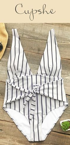 A design that's the essence of beach life, Cupshe Quiet Elegance Stripe One-piece Swimsuit gonna let you swim along the beach or in the pool with a vibrant, sunny style. This one-piece features black & white straps and tie design on front. Free shipping & Check it out!