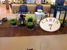 Table decor from the evening party included lanterns, burlap, and candles