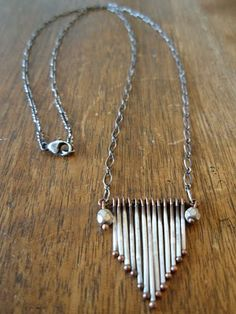 porcupine quill necklace. want! I miss playing tug of war with my little porcupine friends