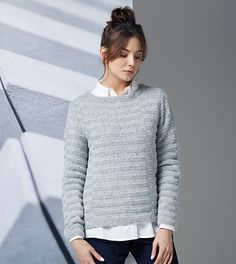 Farrell has a great fondness for exposed concrete blocks used in architecture, which is what influenced the simple asymetric, positive/negative blocks pattern that covers this classic jumper.