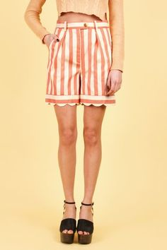 I wore a similar orange striped shorts outfit like this when I was about 15! Hideous then, and just an updated version of hideous now! :)