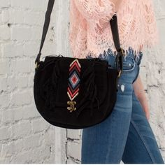"Bohemian shoulder bag Black fringe shoulder bag. Size: 7"" L x 9""W. Faux suede with faux leather strap. No Trades. Price is firm unless bundled.  First photo courtesy of April Spirit. April Spirit Bags Shoulder Bags"