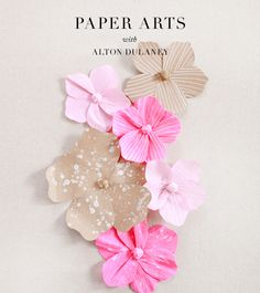 Flower invitations handwritten on paper flowers? Tons of work but kind of cute...