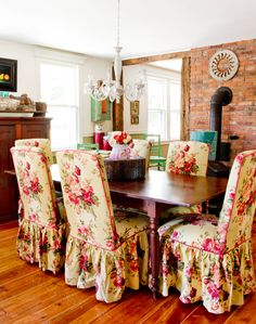 While it might seem hard to match these chairs, which are covered in English cabbage-esque flowers, with anything, Amanda embraced similar colors to accessorize the dining room. The exposed brick wall also helps anchor the room.