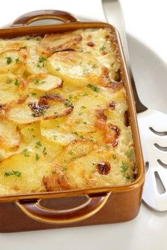 Old Fashioned Scalloped Potatoes Recipe  This easy potato recipe is requested often.  Easy to make and scrumptious.  BEST HOMEMADE SCALLOPED POTATO RECIPE  4 cups potatoes, thinly sliced 3 TBS  homemade unsalted butter 3 TBS flour 1-1/2 cups  evaporated milk 1 tsp kosher salt dash  homemade cayenne pepper  paprika, for garnish  PREHEAT oven to 350 degrees and you will need a greased casserole dish.  In a small saucepan, melt the butter and then whisk in the flour.  Let  it cook for a minute…