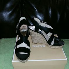 """Michael Kors Wedge  Black Description  Womens Sizes 91/2 Metallic leather upper Adjustable buckle ankle strap for easy on/off Leather/Synthetic lining Open toe, strappy construction .75"""" platform Approximately 4.50"""" cute wedge heels Michael Kors Shoes Wedges"""