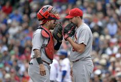 Catcher Yadier Molina talks with starting pitcher Michael Wacha during the 5th inning against the Cubs. Cards lost 3-0.  5-03-14