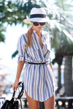 Trendy blonde in striped shirtdress and Panama hat