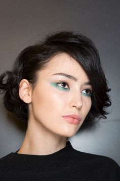 Try a line of blue sparkle under your lower lashes as seen at Etienne Aigner.