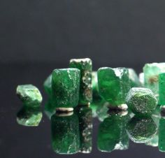 I want to make earrings out of these SO BAD  Emerald Raw Crystals by RockGardenGems on Etsy, $8.00