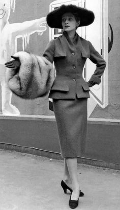 1954 - Christian Dior's wool town suit worn with fur hat & fox muff photo by Willy Maywald