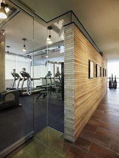Love the glass doors to the home gym #homegym www.OakvilleRealEstateOnline.com maybe bamboo like wallpaper?