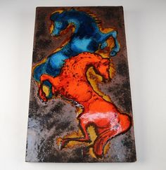 "This tile has two fiery stallions in red and blue glazes against a dark, glittery backdrop. The back is stamped ""Ruscha handgemalt"" meaning ""painted by hand."". large hand painted German ceramic art tile by Ruscha. 
