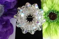 Aurora Borealis Crystal Round Rhinestone Brooch Measures 2 inches in Diameter by CCCsVintageJewelry on Etsy