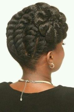 Hair cornrowed and then flat twisted into a side bun