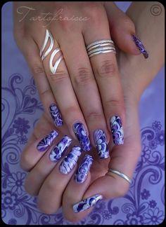 Purple flower nail art.