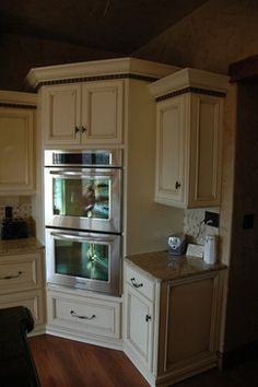 White Cabinets, Double Oven In Corner.