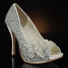 HIGH-FALOOTIN BY BENJAMIN ADAMS AND MY GLASS SLIPPER: Sparkly peep toe pump with flower decoration at MyGlassSlipper.com, $469.     http://www.myglassslipper.com/designer-wedding-shoes/benjamin-adams