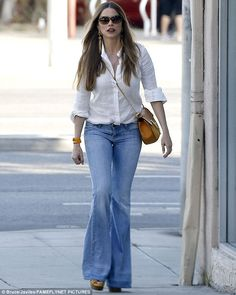 Flare for fashion: The saucy stunner looked in fine form indeed in her bell bottom denims