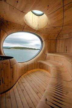 """Wooden Curved Cabin  Partisans has designed """"Grotto"""", an amazing sauna located in Ontario's nature, Canada, offering a wonderful view of the surrounding landscape. Its exterior structure, simple, minimalist and linear is so astonishing as its interior design, complex, featuring very elaborated shapes and ergonomics.:"""