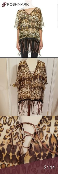 """One Teaspoon leopard print leather Fringe top NWT Super cool fringe sheer leopard print poncho by One Teaspoon. Leather fringe trim and leather lace detail at bustline. Sides are not completely open. Armhole approx 14"""" Size 8. NWT. 100% cotton excluding fringe. Approx measurements  24"""" shoulder to hem excluding fringe 36"""" shoulder to hem with fringe Bust 42"""" One Teaspoon Tops"""