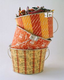 Tin paint buckets become something else entirely when they're decoupaged with Halloween-candy wrappers (or other favorite candy).